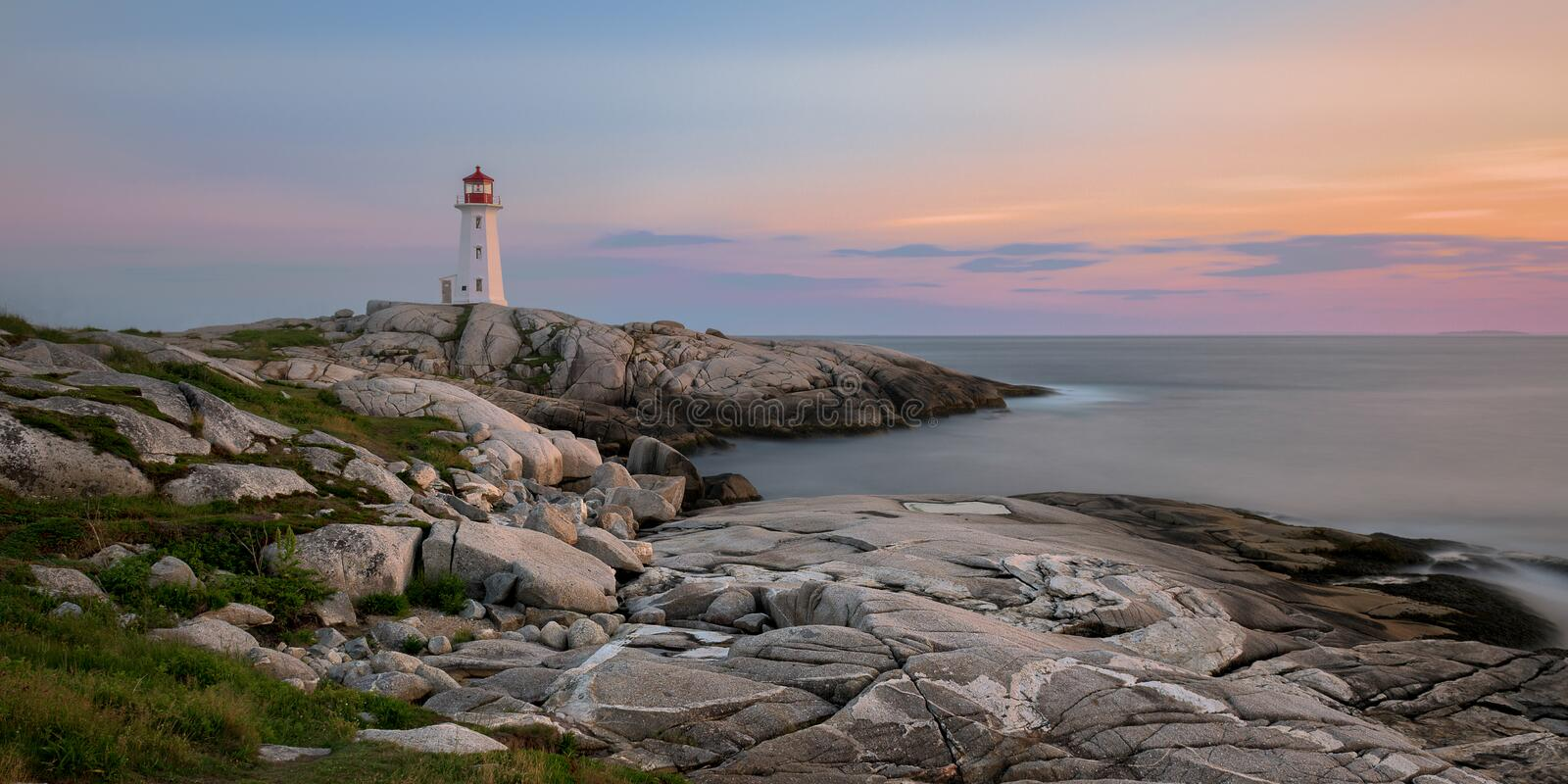 Peggy`s Point Lighthouse at sunset stock image