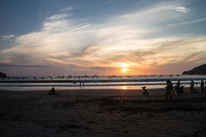 Sunset with people on beach from San Juan del Sur, Nicaragua stock photo