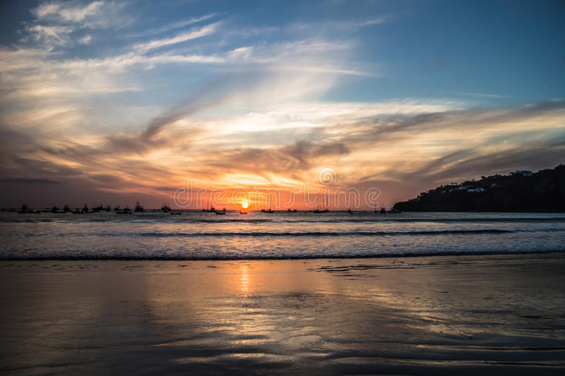 Sunset with people on beach from San Juan del Sur, Nicaragua. San Juan del Sur, Nicaragua March 9, 2016 sunset with people on beach stock photography