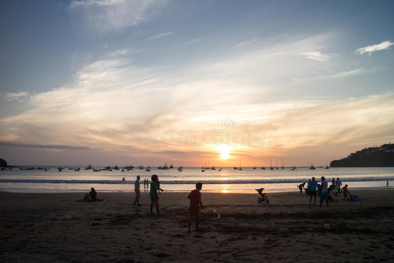 Sunset with people on beach from San Juan del Sur, Nicaragua royalty free stock images