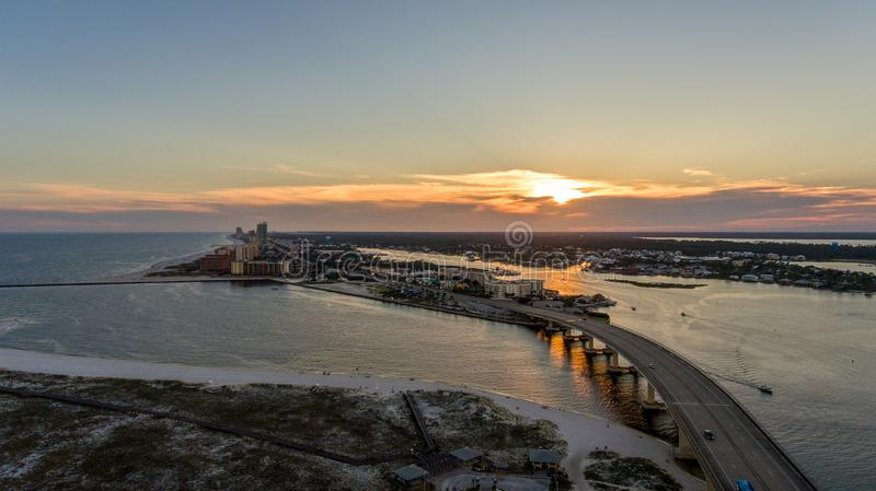 Sunset at Perdido Pass in Orange Beach, Alabama. Mobile, bay, seascape, evening, sky, beach, bridge, dusk, park, pier, waterfront, travel, usa royalty free stock photos