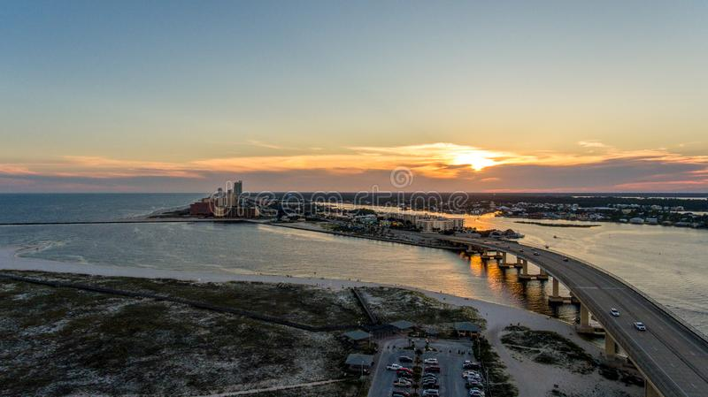 Sunset at Perdido Pass in Orange Beach, Alabama. Mobile, bay, seascape, evening, sky, beach, bridge, dusk, park, pier, waterfront, travel, usa stock image