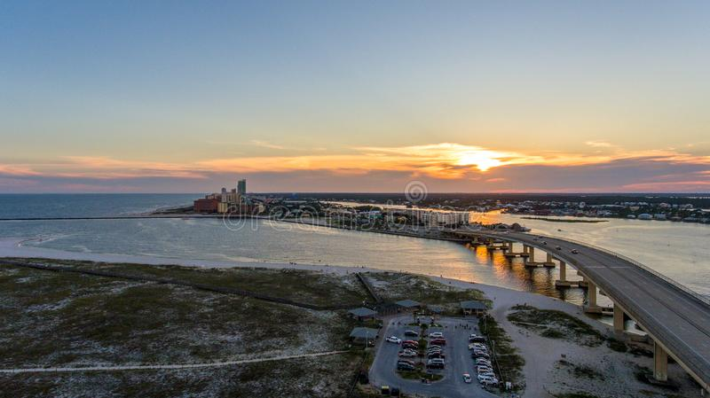 Sunset at Perdido Pass in Orange Beach, Alabama. Mobile, bay, seascape, evening, sky, beach, bridge, dusk, park, pier, waterfront, travel, usa stock photo
