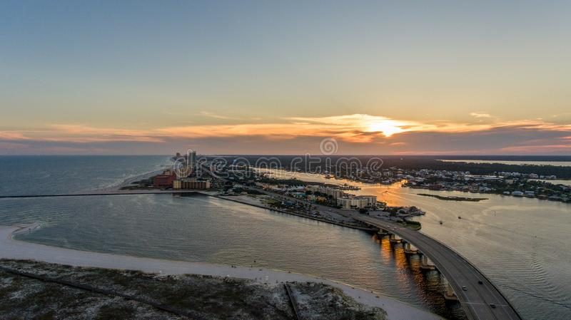 Sunset at Perdido Pass in Orange Beach, Alabama. Mobile, bay, seascape, evening, sky, beach, bridge, dusk, park, pier, waterfront, travel, usa royalty free stock photography