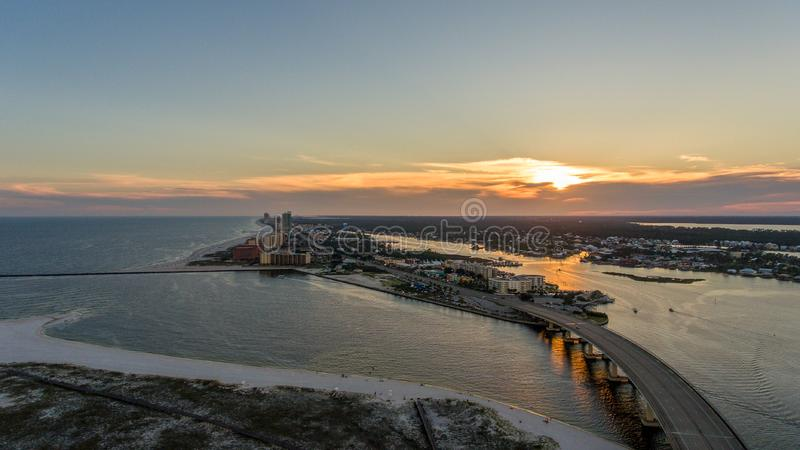 Sunset at Perdido Pass in Orange Beach, Alabama. Mobile, bay, seascape, evening, sky, beach, bridge, dusk, park, pier, waterfront, travel, usa stock photography
