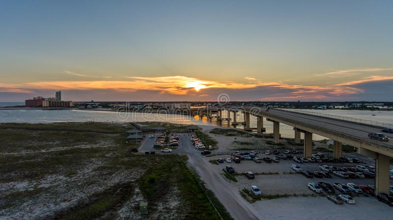 Sunset at Perdido Pass in Orange Beach, Alabama. Mobile, bay, seascape, evening, sky, beach, bridge, dusk, park, pier, waterfront, travel, usa royalty free stock photo