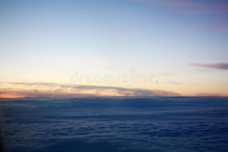 Sunset photo from the flying plane royalty free stock images