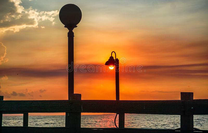 Sunset on a pier on the beaches of the Caribbean royalty free stock image