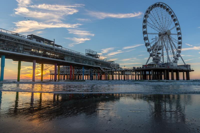 Sunset at the pier in Scheveningen Holland royalty free stock photo