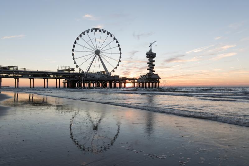 Sunset at the pier in Scheveningen Holland stock image
