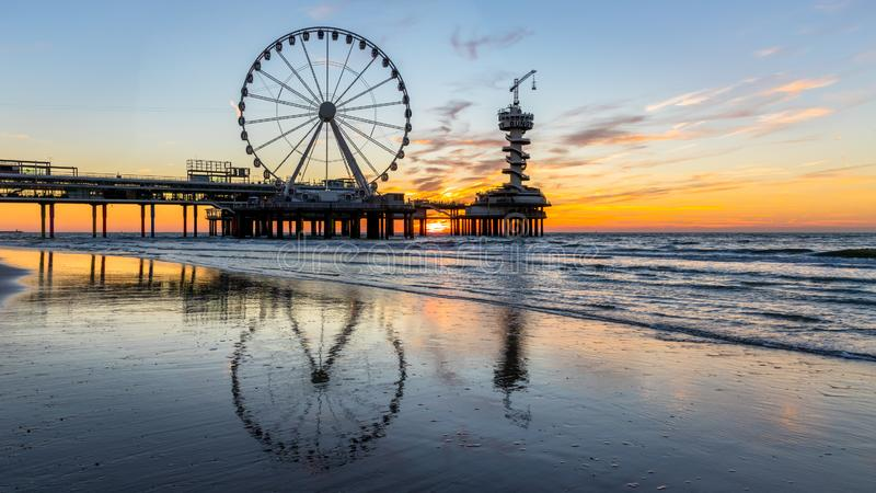 Sunset at the pier in Scheveningen Holland stock photography