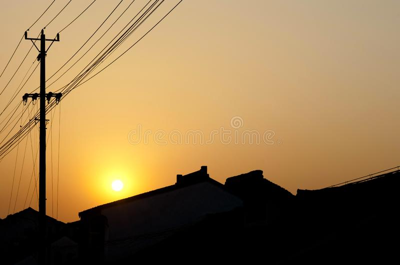 Sunset on Pingjiang Road, Suzhou, showing silhouettes of traditional Chinese rooves royalty free stock image