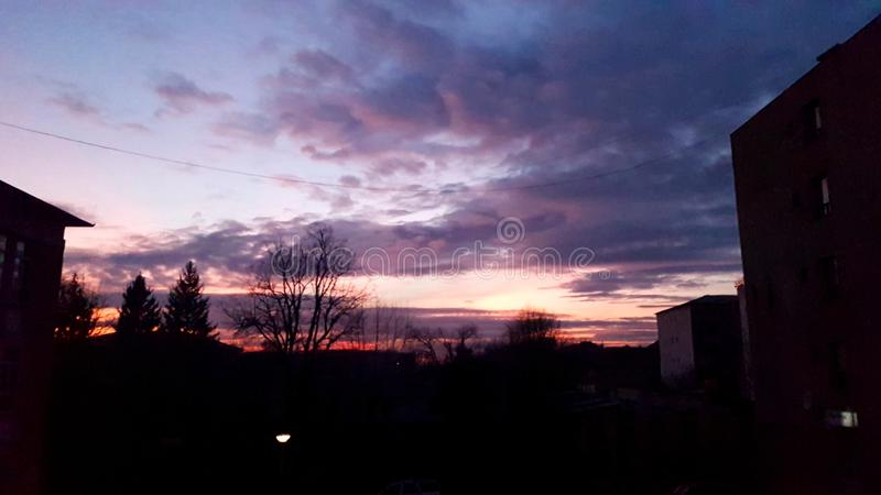 Sunset. Pink sunset in Romania with black bottom and blue top royalty free stock images
