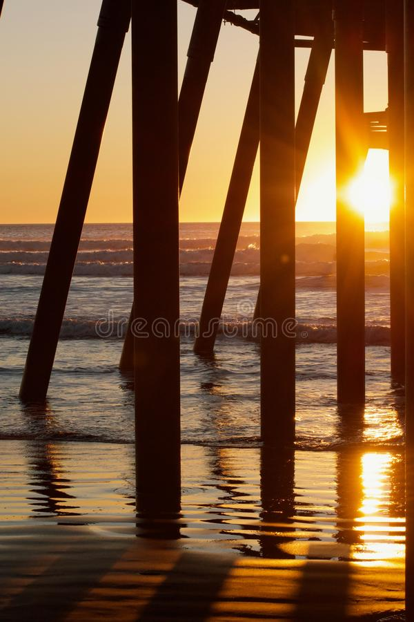 View from under the pier during sunset royalty free stock image