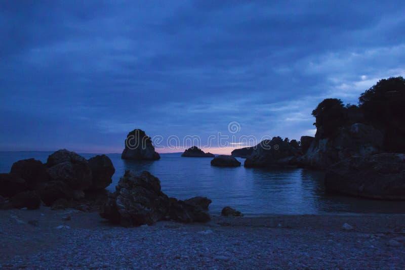Sunset on Piso Krioneri Beach Parga Greece stock image