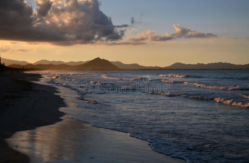 Sunset at playa de Muro en Balearic Islands. Spain. Sunset at playa de Muro en Balearic Islands, with beautiful reflections of the sea stock photos