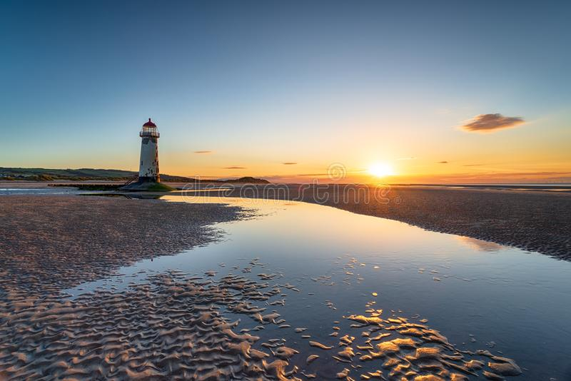 Point of Ayr Lighthouse at Talacre in Wales. Sunset at the Point of Ayr lighthouse on the beach at Talacre in Flintshire in north Wales royalty free stock photos