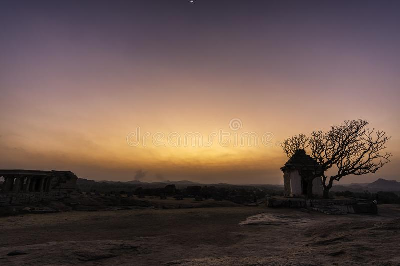 Sunset point in hampi karnakata india isolated house with silhouette tree colorful stock photos