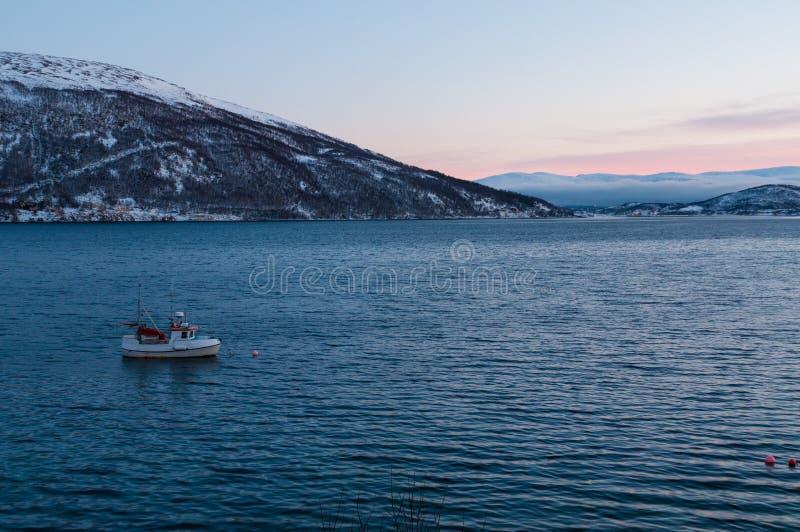 Sunset during Polar Night near Kvaloya village in Norway.  royalty free stock images