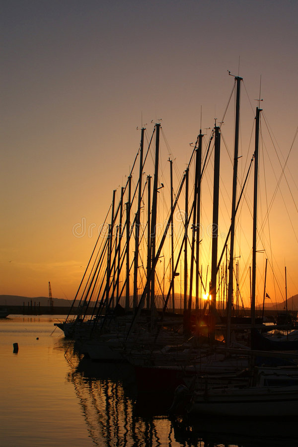 Sunset in the port Alghero royalty free stock images