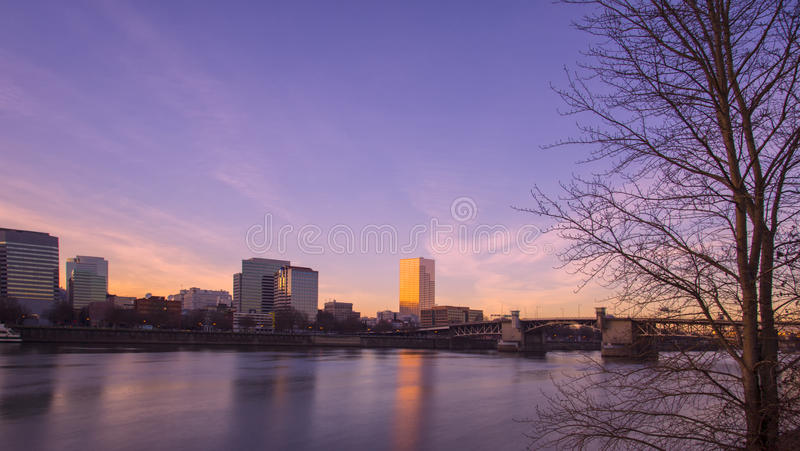 Sunset in Portland, OR. The beautiful view of the skyline and Willamette River is seen from riverfront park of Portland royalty free stock photography