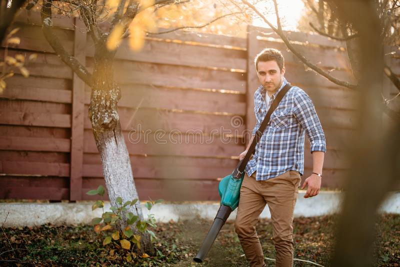 Portrait of man working in home gardening. Sunset portrait of man working in home gardening stock photos