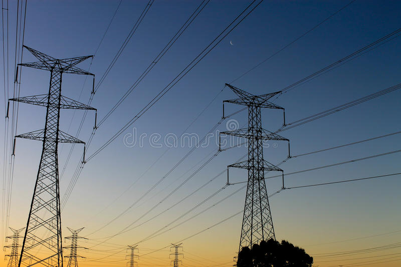 Sunset Power Lines. Sun setting over power lines outside Perth's ice rink stock photos
