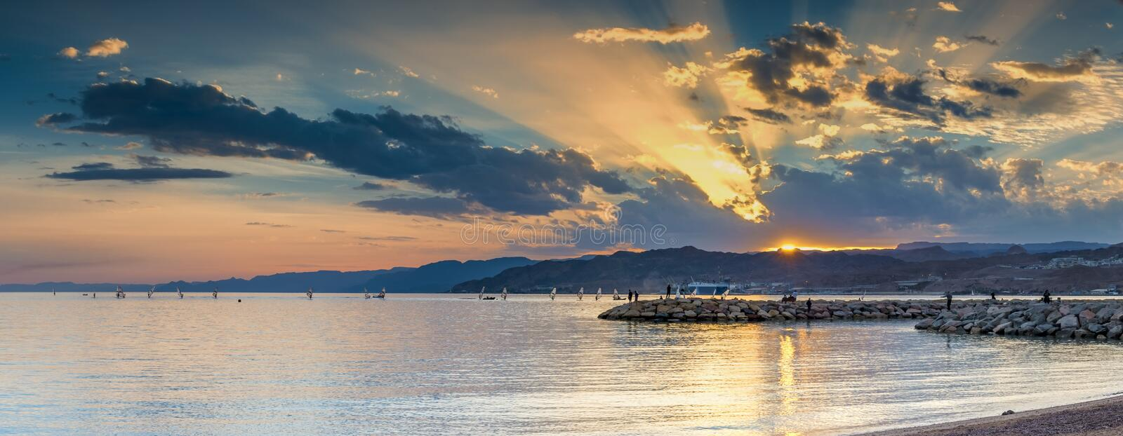 Sunset at a public beach of Eilat - famous resort city in Israel stock image
