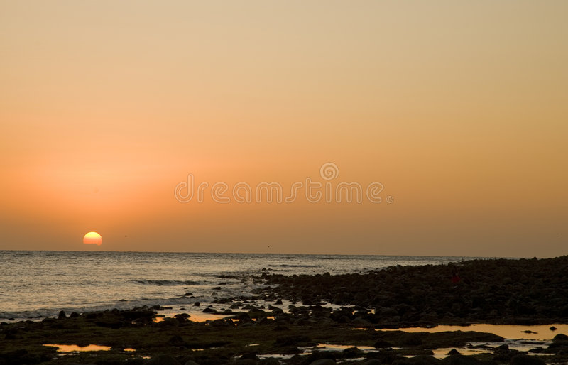 Sunset at Puerto Penasco, Mexico. Sunset over a rocky beach at Puerto Penasco (Rocky Point) Mexico royalty free stock image