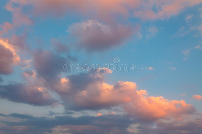 Sunset with purple clouds and the sky in background stock photo