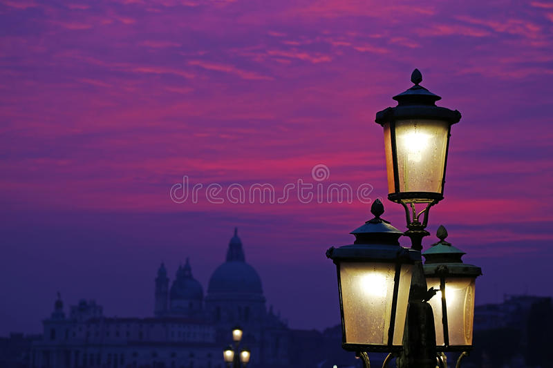 Sunset purple and lanterns lit street in Venice, Italy stock photography