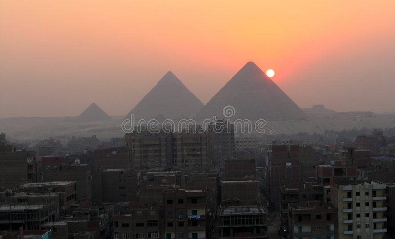 Sunset and the pyramids royalty free stock photos