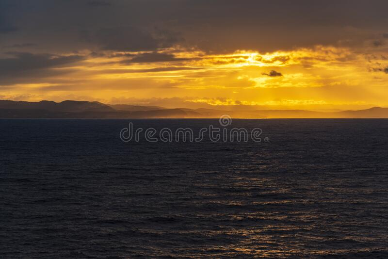 Sunset and rain clouds over Jamaica`s north shore. Jamaica, a Caribbean island nation, has a lush topography of mountains, rainforests and reef-lined beaches stock photo