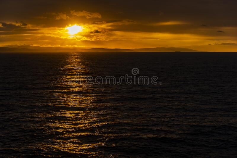 Sunset and rain clouds over Jamaica`s north shore. Jamaica, a Caribbean island nation, has a lush topography of mountains, rainforests and reef-lined beaches stock image