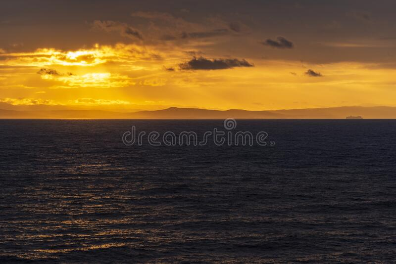 Sunset and rain clouds over Jamaica`s north shore. Jamaica, a Caribbean island nation, has a lush topography of mountains, rainforests and reef-lined beaches royalty free stock images