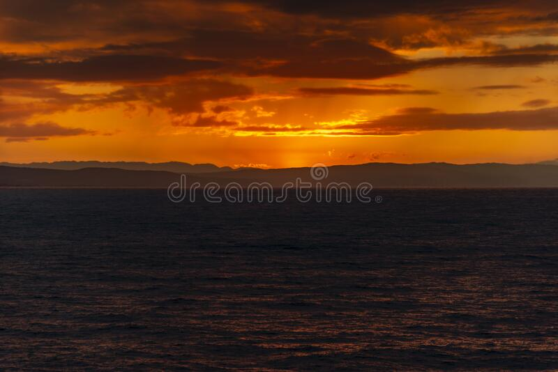 Sunset and rain clouds over Jamaica`s north shore. Jamaica, a Caribbean island nation, has a lush topography of mountains, rainforests and reef-lined beaches royalty free stock image