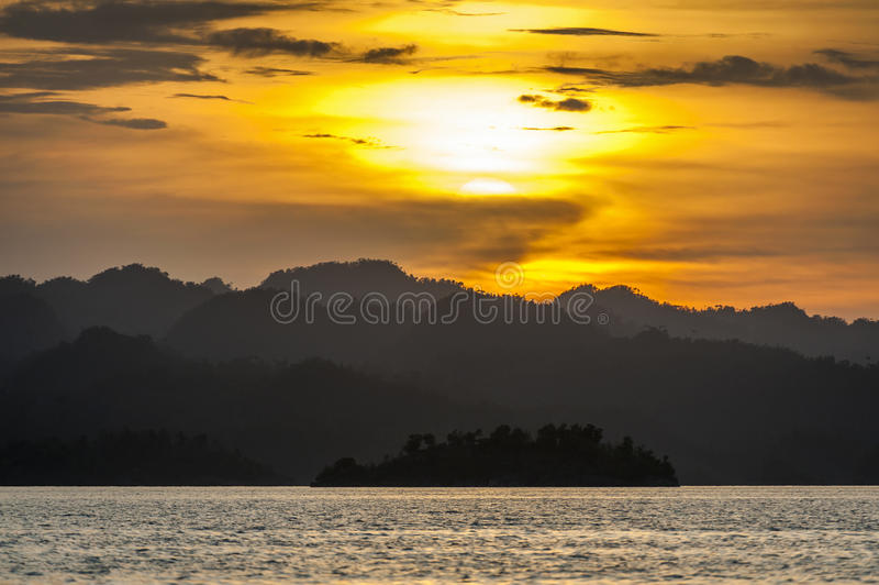 Sunset in the Raja Ampat Islands,Indonesia. Raja Ampat is an archipelago comprising over 1,500 small islands and is the part of Coral Triangle which contains the royalty free stock photography