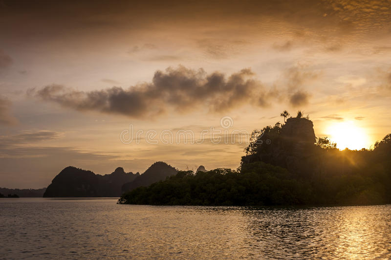 Sunset in the Raja Ampat Islands,Indonesia. Raja Ampat is an archipelago comprising over 1,500 small islands and is the part of Coral Triangle which contains the stock images