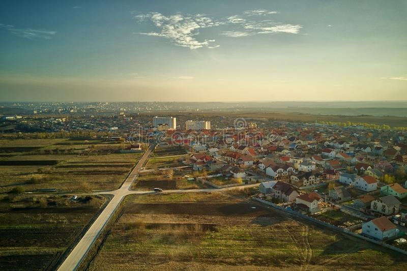 Sunset real estate suburb homes. Community suburbia neighborhood in Moldova. Aerial drone view above new development royalty free stock photos