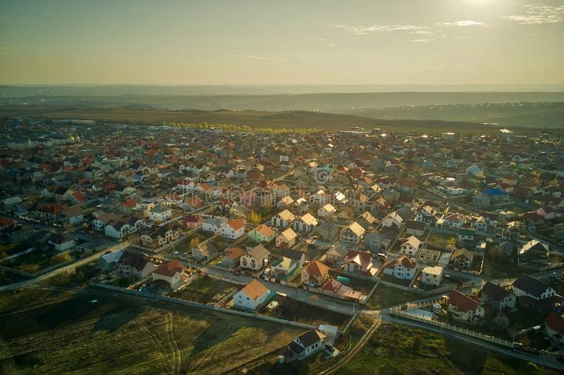 Sunset real estate suburb homes. Community suburbia neighborhood in Moldova. Aerial drone view above new development royalty free stock photo