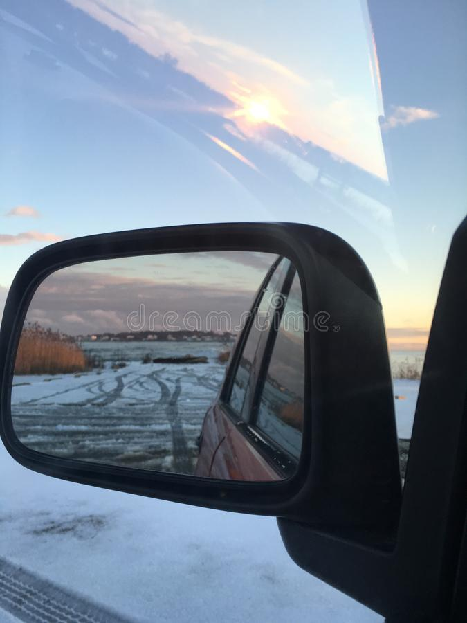 Sunset in the rear view mirror royalty free stock photos
