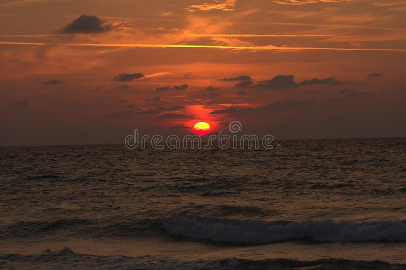 Sunset. A red sunset on atlit city beach royalty free stock photo