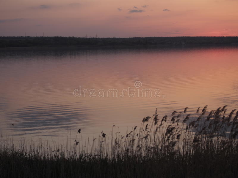 Sunset reflected in lake stock image