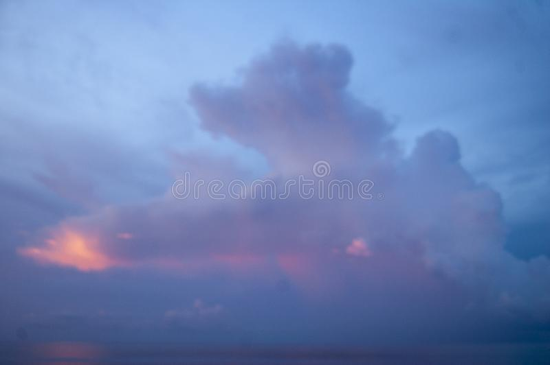 Sunset reflecting of clouds in the night sky royalty free stock photo