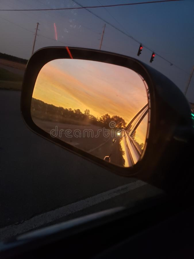 Sunset reflecting off my car mirror royalty free stock photo
