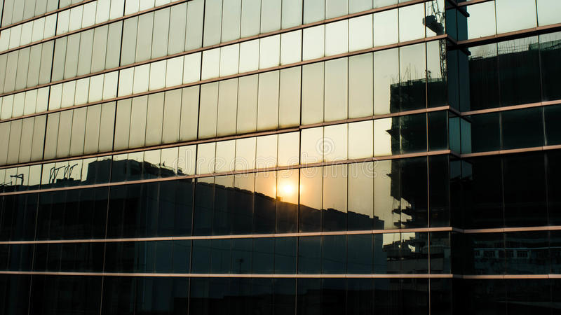 Sunset reflection on building windows royalty free stock photos