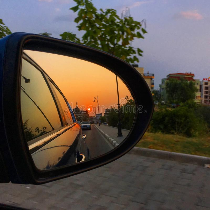 Sunset reflection in the car mirror. Sunset reflection cqr car mirror stock photo