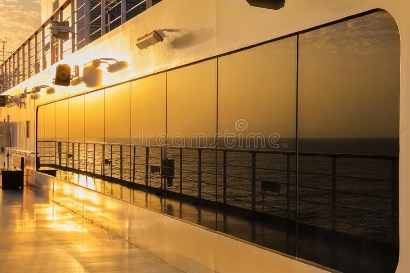 Sunset reflection on deck of an ocean cruise ship royalty free stock photography