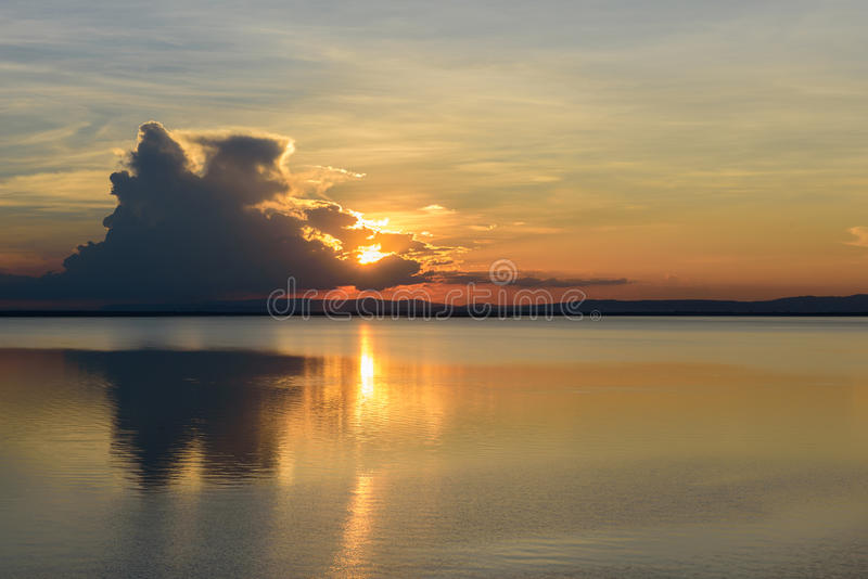 Sunset reflection over the dam. royalty free stock photo