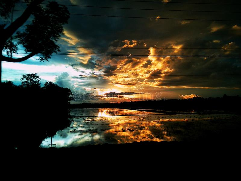 Reflection. The sunset reflection in a watery field in shylet, Bangladesh royalty free stock photo